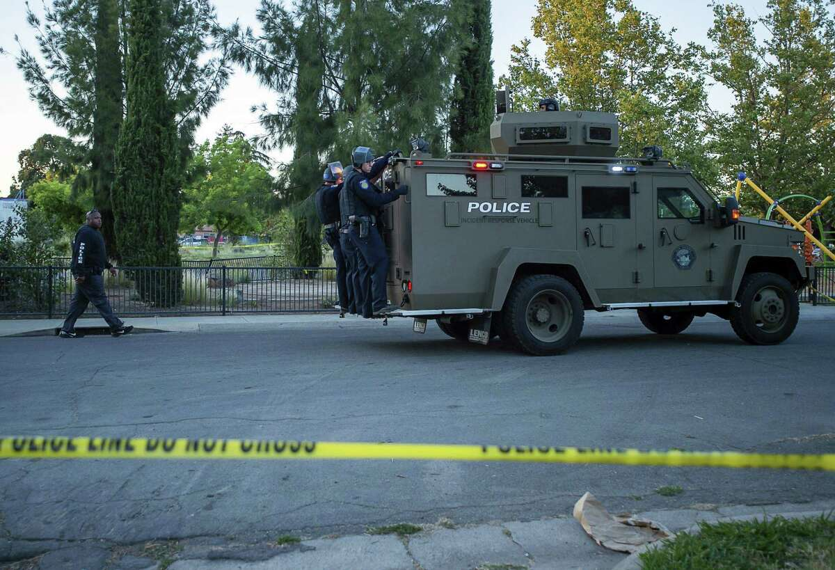 Sacramento police officers respond to a shooting on Redwood Avenue in the Noralto neighborhood on June 19, 2019.