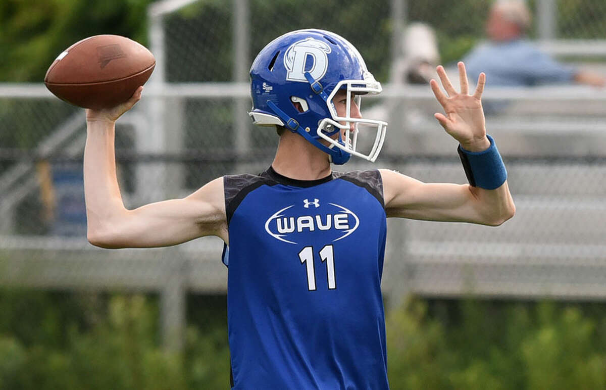 Wave quarterback Peter Graham looks for a receiver downfield. - Dave Stewart photo