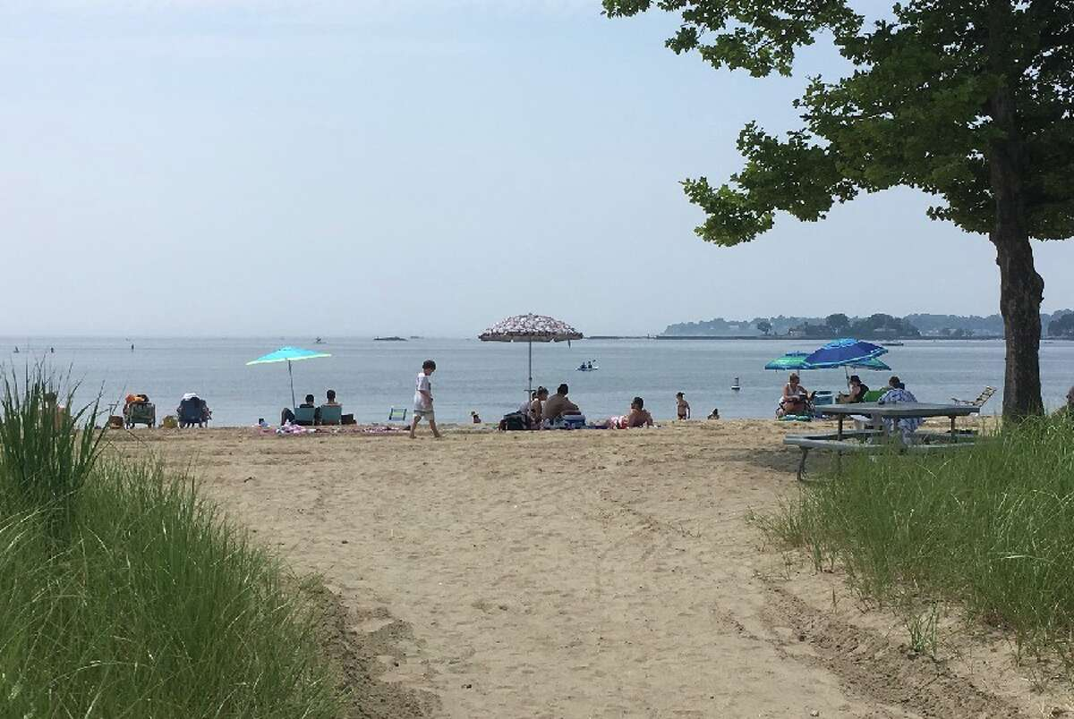 Weed Beach in Darien looking southwest toward Long Island on a hazy July 4. Shippan Point in Stamford is seen at right. - Greg Reilly photo