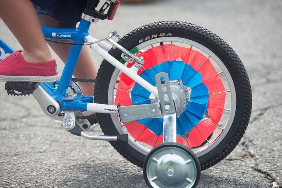 Wheels were decked out for the annual Fourth of July Push-n-Pull parade in Darien