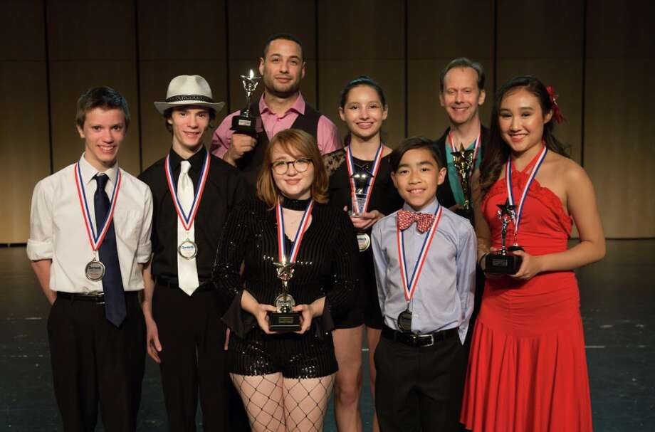 This year's  Darien's Got Talent winners — Anton and Joseph Klettner, left, second place, children; Grace Herbert, second place, adult; Erick Sanchez (in rear) third place, adult; Isabelle Seeman, People's Choice Award; Mia and Kai Sparks, third place, children's and Tom Giles (in rear) first place, adult.