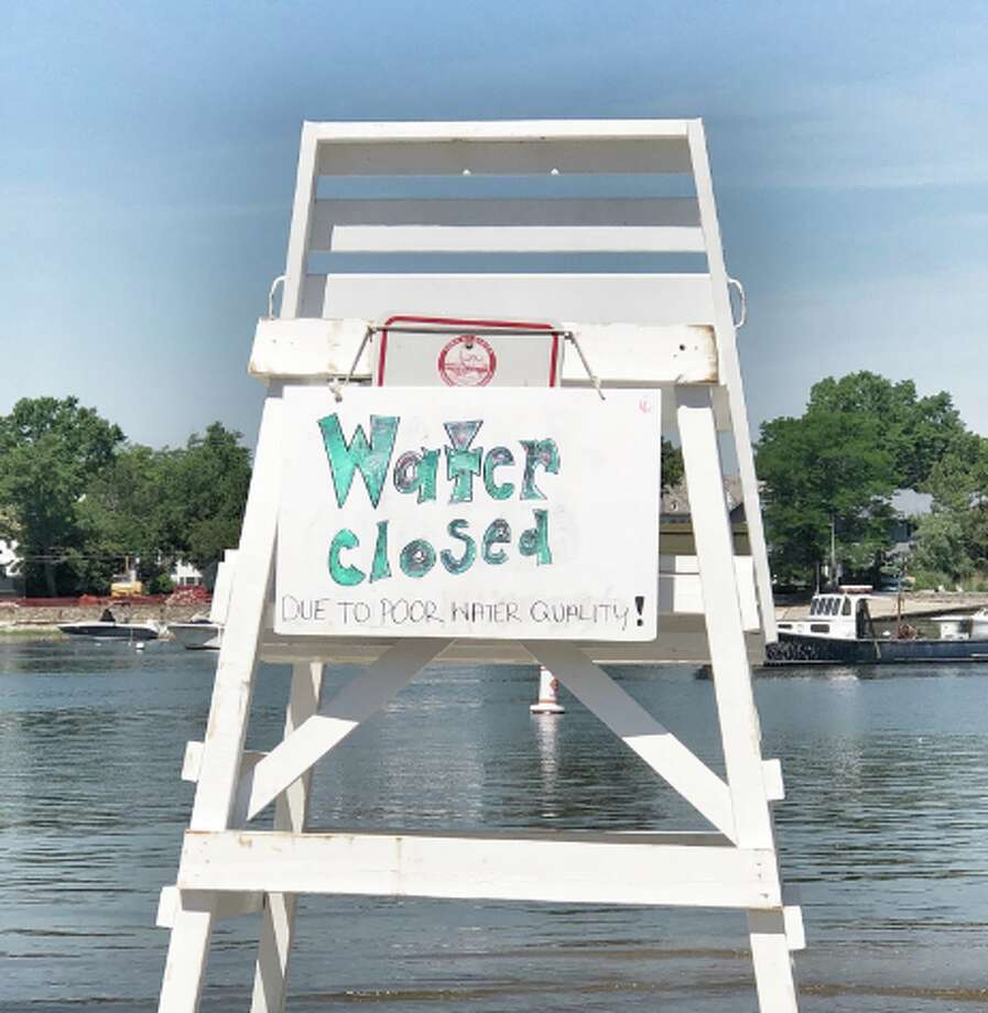 A sign on Friday in Darien after water quality closed the beaches courtesy Darien Police.
