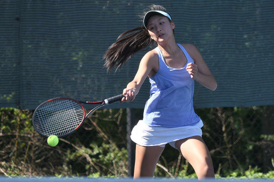 Wave ace Lilly Ma, shown in action during Darien's victory over rival New Canaan, was named the FCIAC's Player of the Year. — Dave Stewart photo