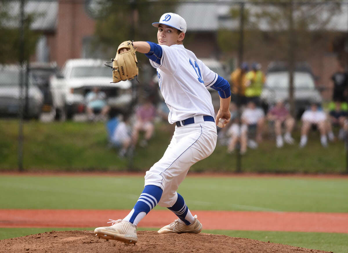 Darien's Henry Williams fires in a pitch during a Blue Wave victory in 2018. - Dave Stewart photo