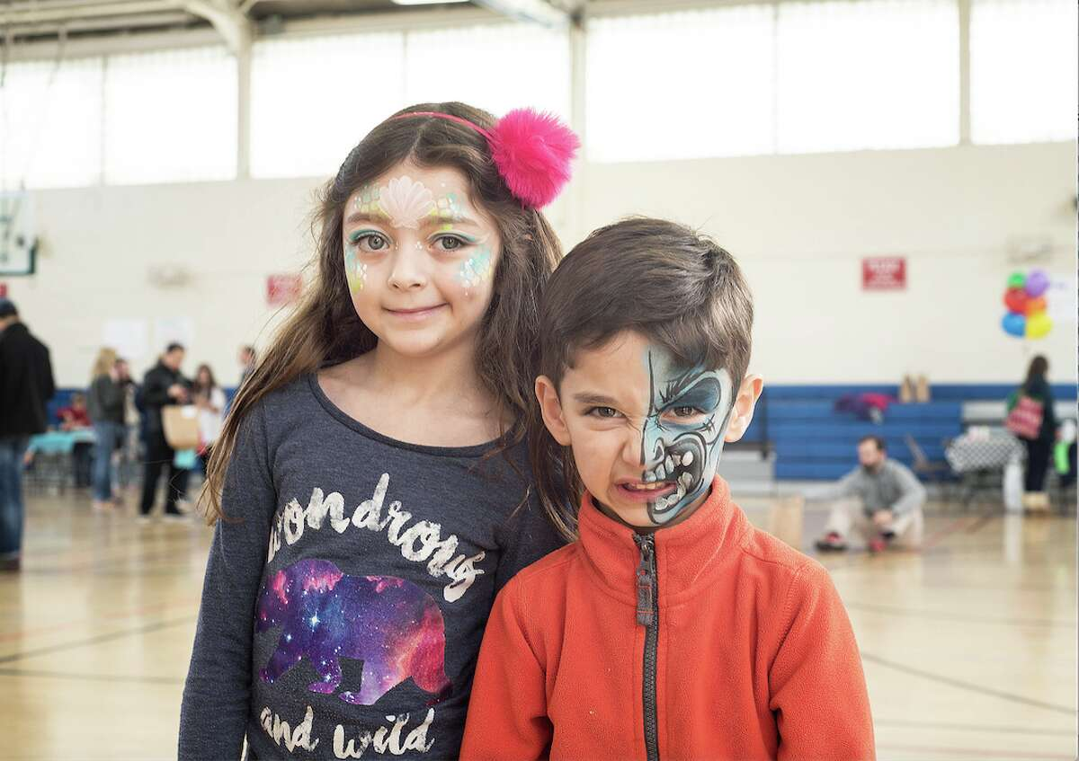Seven-year-old Elena Cappella and her brother, Neil, 5, show off their freshly painted faces.