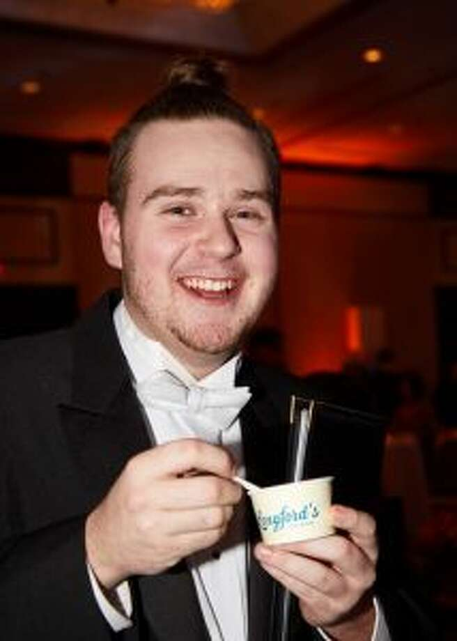 Darien High School Choir singer Jeremy Merrifield takes a break with some ice cream.