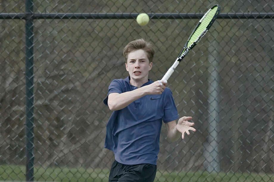 Darien's Nick Derby returns a shot during a Blue Wave victory last spring. Derby, a junior who played at No. 2 singles last year, returns as a key player in the Wave's singles lineup this season. — Scott Mullin photo / Scott Mullin ownership