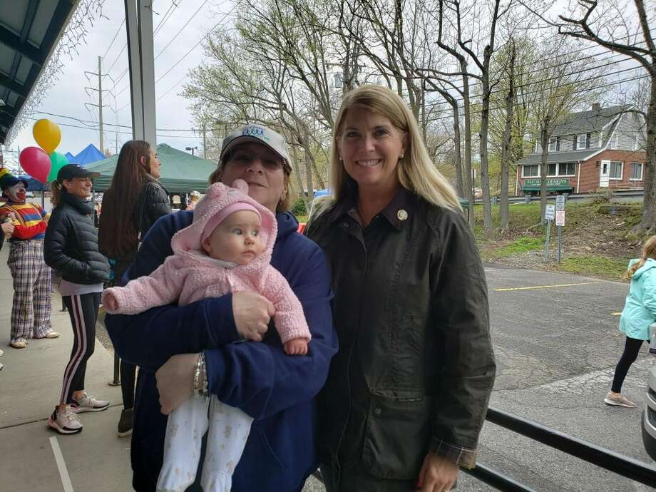 From left, Janice Marzano, program director at the Darien Depot, Marzano's 6-month-old granddaughter Miley Shea Marzano, and Darien First Selectman Jayme Stevenson at the Depot's Community Health Awareness Fair. — Sandra Diamond Fox photo