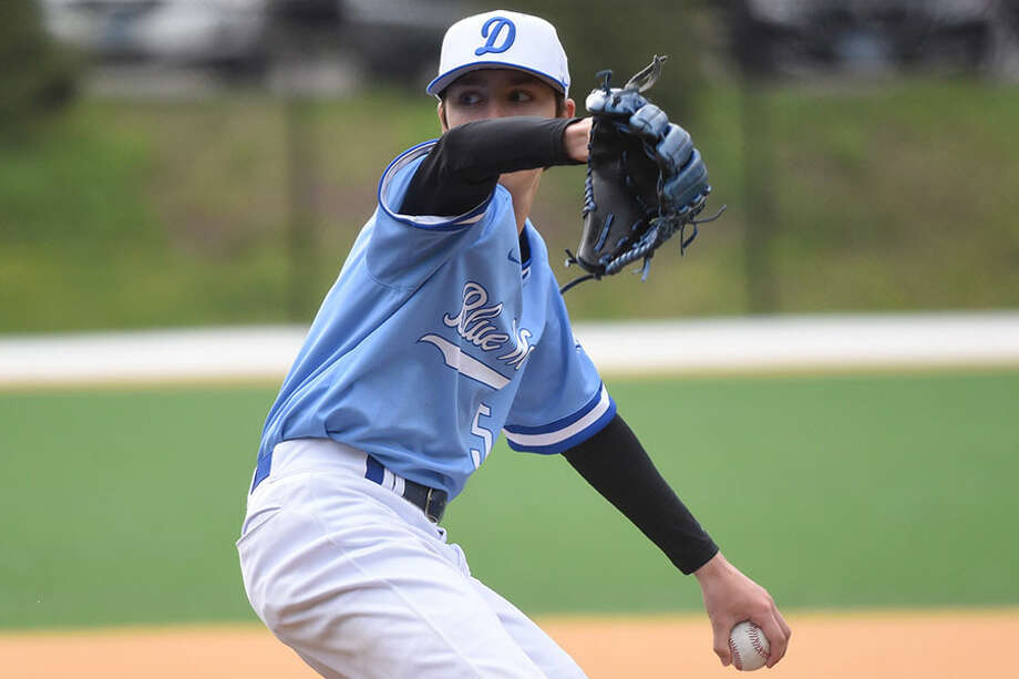 Darien's Trace Florio (5) pitches during the Blue Wave's baseball game with the Ridgefield Tigers at Darien High School on Tuesday, April 30, 2019. — Dave Stewart/Hearst Connecticut Media / Hearst Connecticut Media