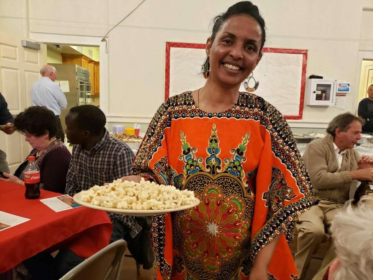 An Eritrean refugee shows the meal she has prepared through Ciri's Ethnic Eats program. - Sandra Diamond Fox photo