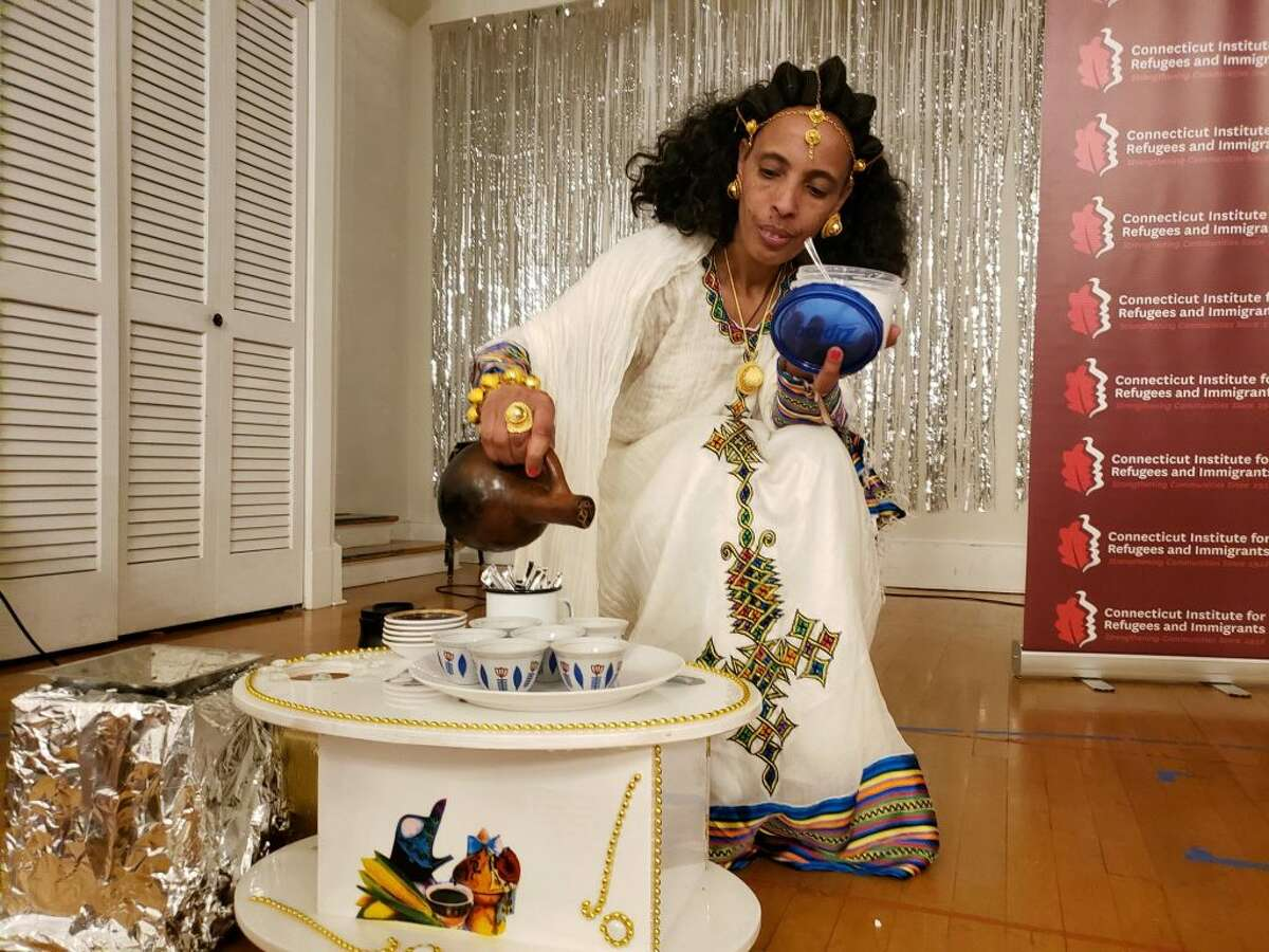An Eritrean woman participates in a traditional Ethiopian coffee ceremony at the First Congregational Church in Darien. - Sandra Diamond Fox photo