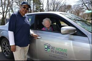 Lillie Williams, left, is a driver for At Home in Darien. Joan Davis, in the car, is getting a ride through the program.