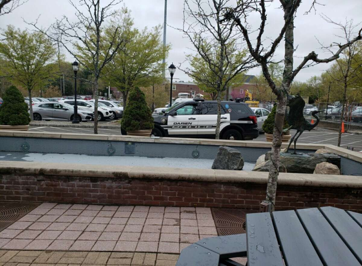Darien Police outside the Darien Library Friday following a theft of personal property - Sandra Diamond Fox photo