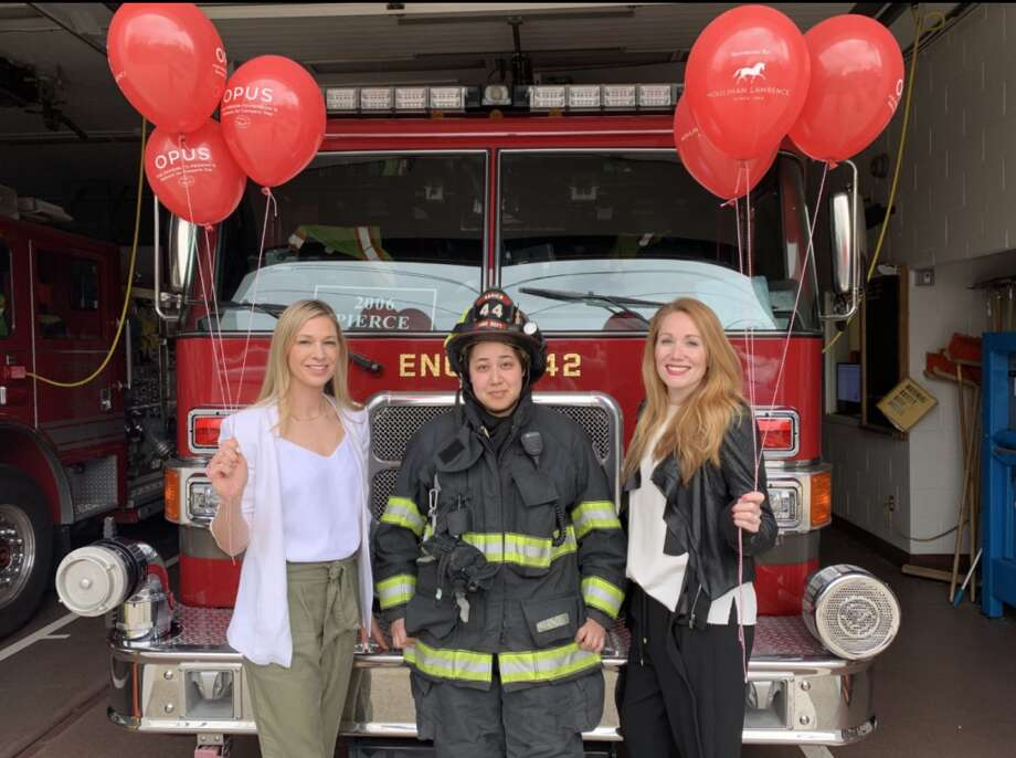 Melanie Brucker, co-president of OPUS for Person-to-Person, Samantha Drayson, Lieutenant and Super of Alarms, Meghan Thornton, OPUS balloon day committee member and board member of the Town of Darien Firefighters Foundation