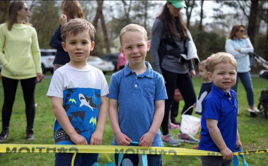 Waiting for the hunt to start are, from left, Quinn McCurdy, 4, Connor Pezley, 4, and Tyler Pezley, 2, all of Darien.