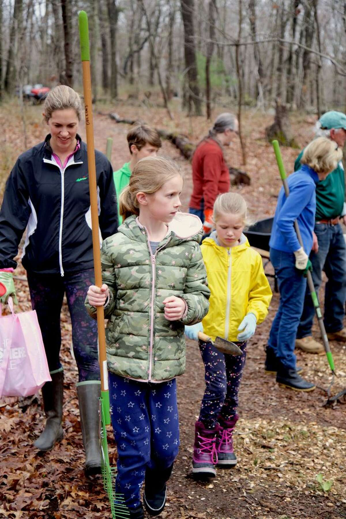 """Helping out are Lauren Collins of Darien and her girls Caroline, 8, and Greta, 6, at the """"Trail Fix"""" clean up at Selleck's and Dunlap Woods on Saturday morning."""