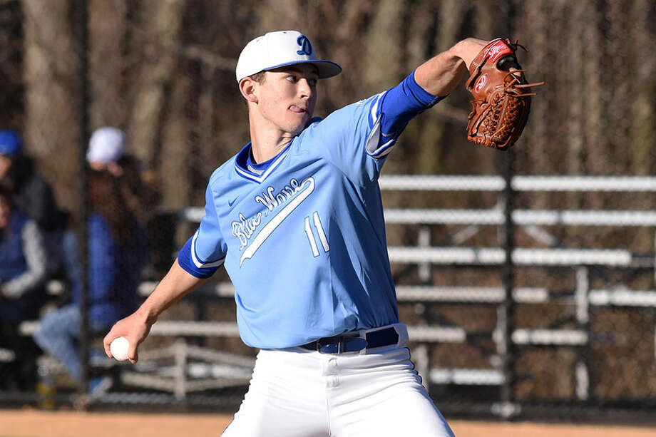 Darien's Henry Williams throws a pitch during the Blue Wave's baseball game against the Trumbull Eagles at Darien High School on Wednesday, April 10. — Dave Stewart/Hearst Connecticut Media / Hearst Connecticut Media