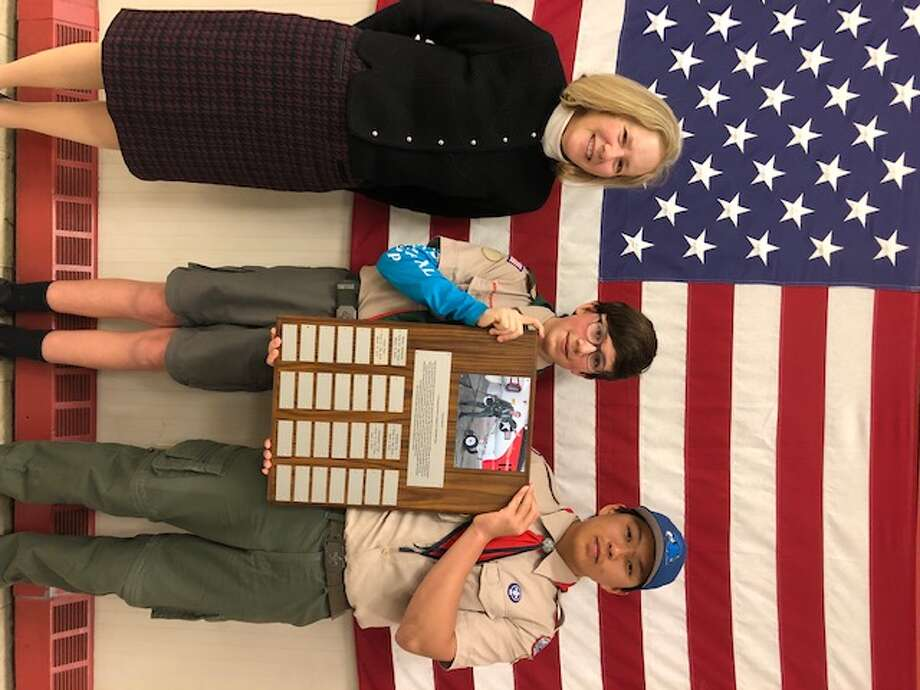 Carolyn Swiggart and Jamie Award winners Christopher Cope and Allen Shao with the award plaque featuring a photo of Jamie Swiggart with his US Navy aircraft.