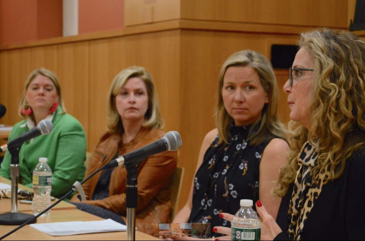 Panelists listen to Ginny Anderson of New Canaan, at right, share about her recovery from alcohol addiction. - Jarret Liotta/Hearst Connecticut Media