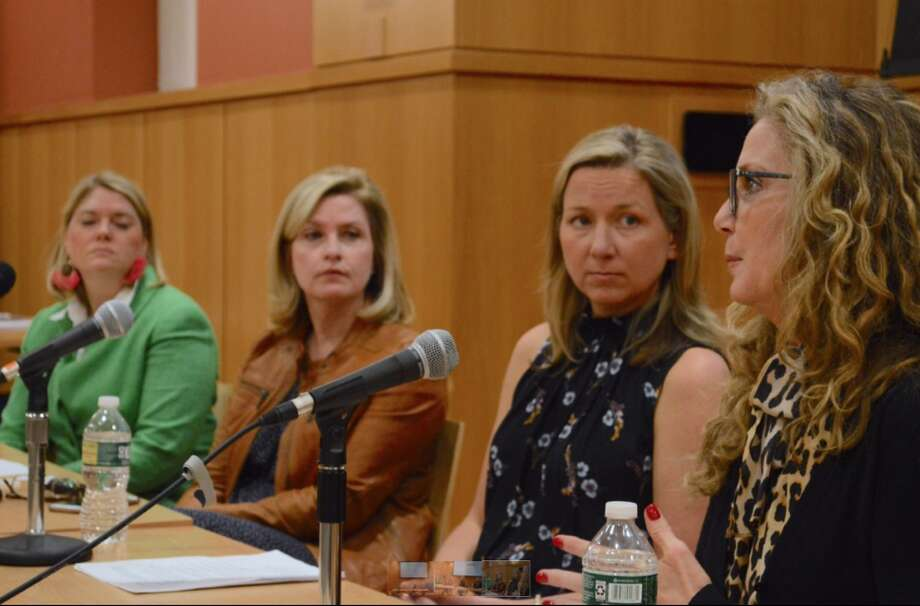 Panelists listen to Ginny Anderson of New Canaan, at right, share about her recovery from alcohol addiction. — Jarret Liotta/Hearst Connecticut Media