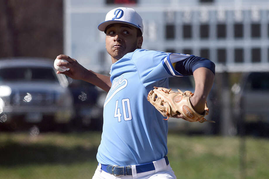 Darien's James Louis fires in a pitch during the Blue Wave's baseball game with Trumbull at Darien High School on Wednesday. — Dave Stewart/Hearst Connecticut Media / Hearst Connecticut Media