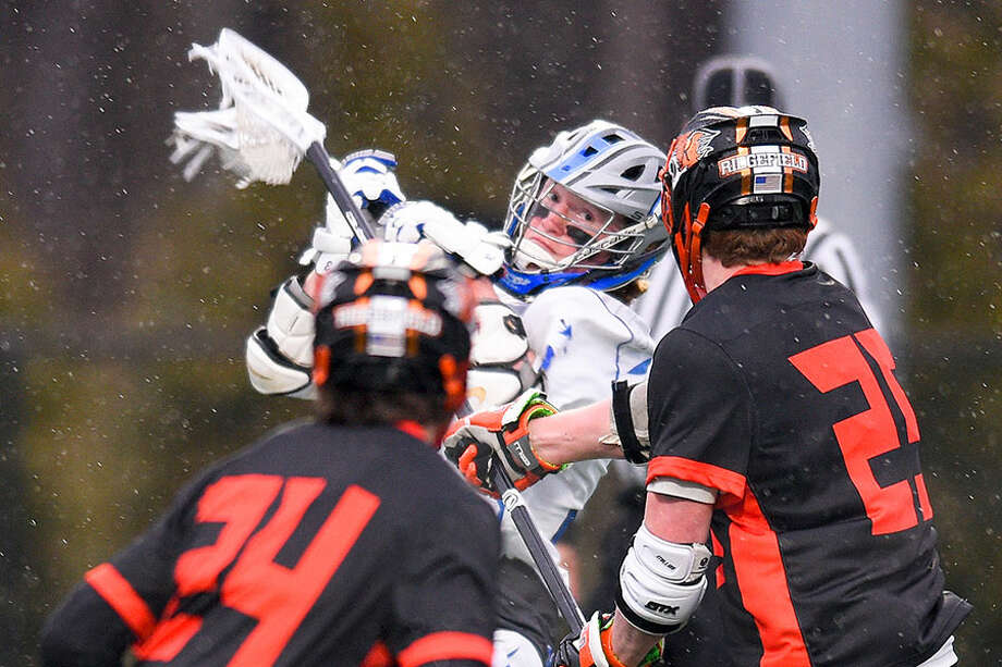 Darien's Hudson Pokorny fires a shotfor a goal in the first quarter of the Wave's boys lacrosse game against Ridgefield in April at DHS. — Matthew Brown/Hearst Connecticut Media / Stamford Advocate