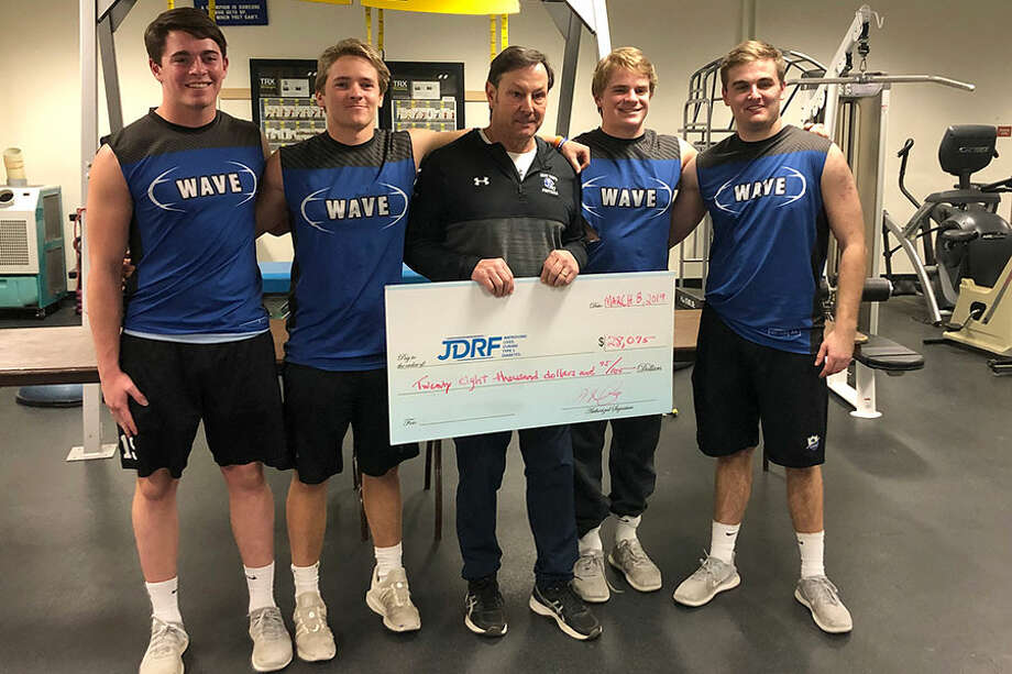 Darien's football captains for the 2019 season with head coach Rob Trifone after the team raised more then $28,000 to support the Juvenile Diabetes Research Foundation. From left are, Will Kirby, John Henry Slonieski, coach Trifone, Sam Wilson and Will Bothwell. — Contributed photo / Contributed photo