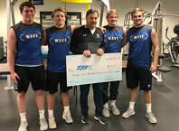 Darien's football captains for the 2019 season with head coach Rob Trifone after the team raised more then $28,000 to support the Juvenile Diabetes Research Foundation. From left are, Will Kirby, John Henry Slonieski, coach Trifone, Sam Wilson and Will Bothwell. — Contributed photo