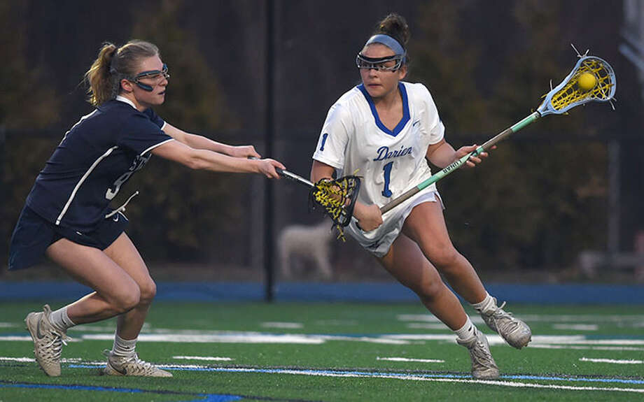 Darien's Nicole Humphrey (1) goes against the Staples' defense during a Wave victory last spring. — Dave Stewart photo