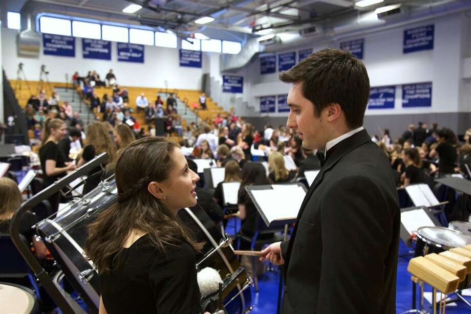 Jackie Benisch, 17, left, and Jack Lowder, 18, prepare to do a piece from West Side Story with the Darien High School Orchestra.