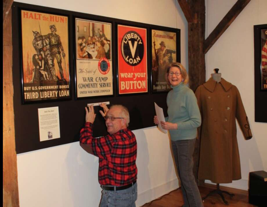 Over Here: Darien's WWI — Dave Polett and Lynn Sheppard, co-curators of the Darien Historical Society's upcoming exhibition on the Great War, put finishing touches on the display, which opens Friday at 7:30 with a Champagne Preview Reception. Tickets are $30 for members and $40 for non-members.