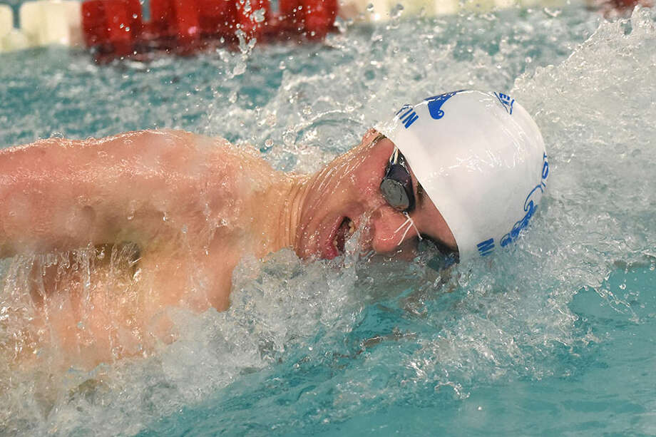 Darien's Connor Martin competes in the freestyle during the FCIAC swim finals in Greenwich on Thursday, Feb. 28. — Dave Stewart/Hearst Connecticut Media / Hearst Connecticut Media