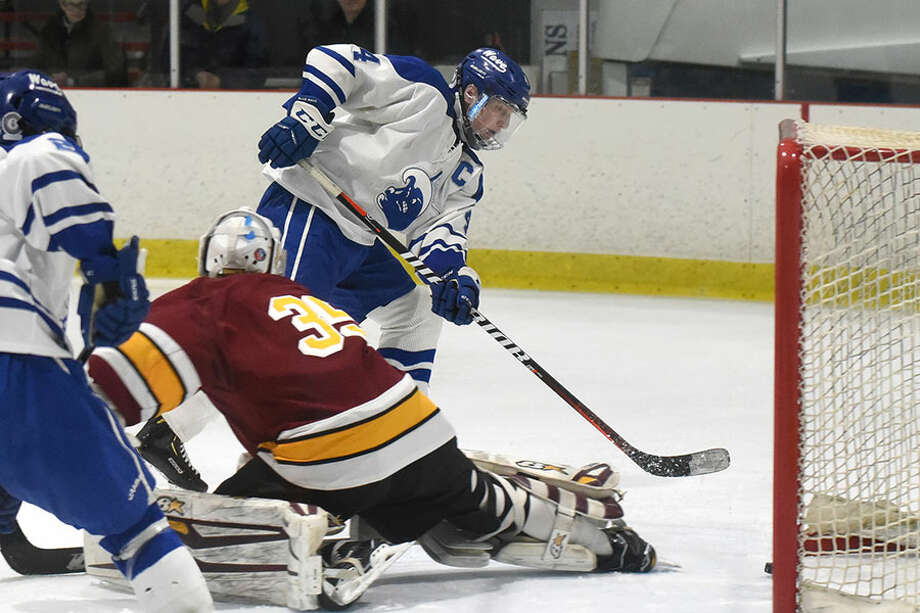 Darien's CJ Hathaway (4) scores past St. Joseph goalie Will Brady (35) during the first round of the CIAC Div. I tournament on Tuesday, March 5, at the Darien Ice House. — Dave Stewart/Hearst Connecticut Media / Hearst Connecticut Media