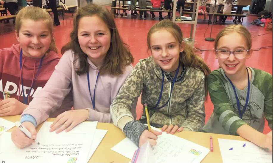 Children in the Tokeneke Kids Care Club write to seniors in a new pen pal program through At Home in Darien.