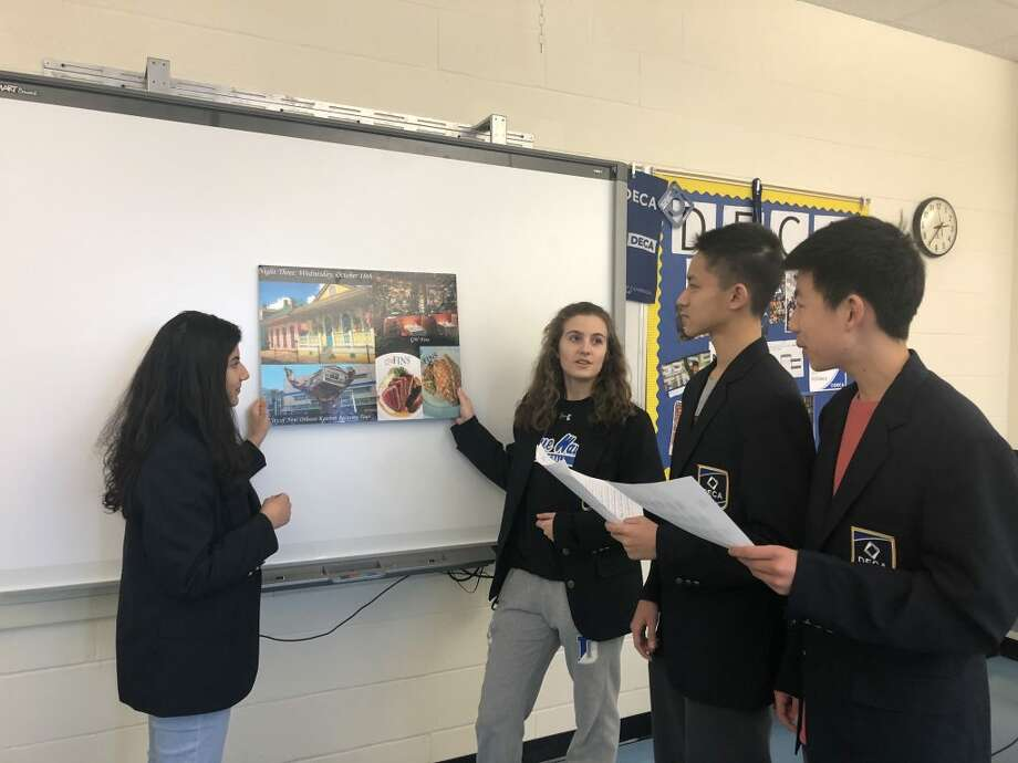 Students from Darien High School's DECA Club: Vincent Xu, Ethan Zhang, Emma Blanke and Maya Nalawade