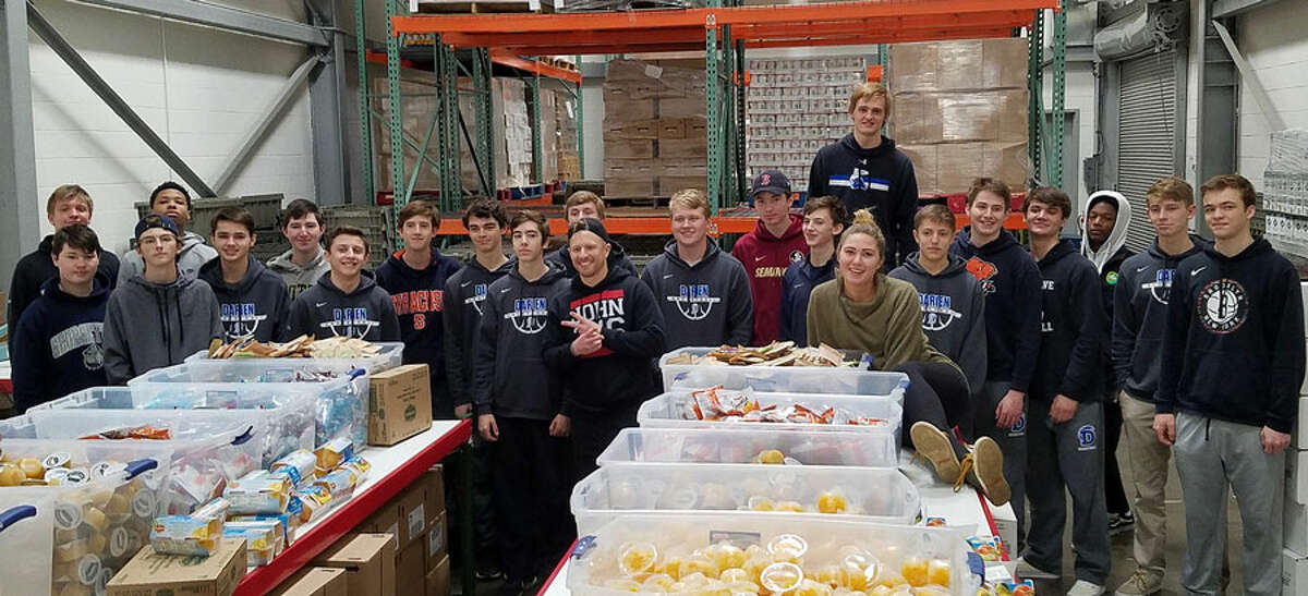 Members of the Darien boys basketball program at Filling in the Blanks on Feb. 21.