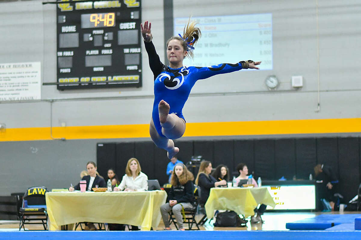 Lana Schmidt of the Darien Blue Wave competes in the floor exercise during the CIAC Class M Gymnastics Championships on Saturday February 23, 2019 at Jonathan Law High School in Milford, Connecticut. - Greg Vasil/For Hearst Connecticut Media
