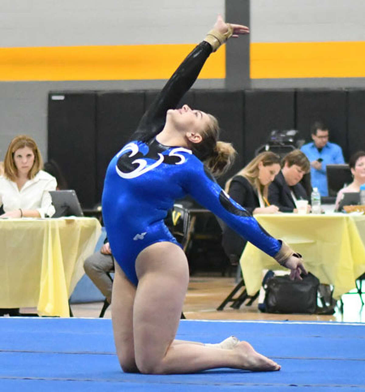 Nicole Carlo of the Darien Blue Wave competes in the floor exercise during the CIAC Class M Gymnastics Championships on Saturday February 23, 2019 at Jonathan Law High School in Milford, Connecticut. - Greg Vasil/For Hearst Connecticut Media