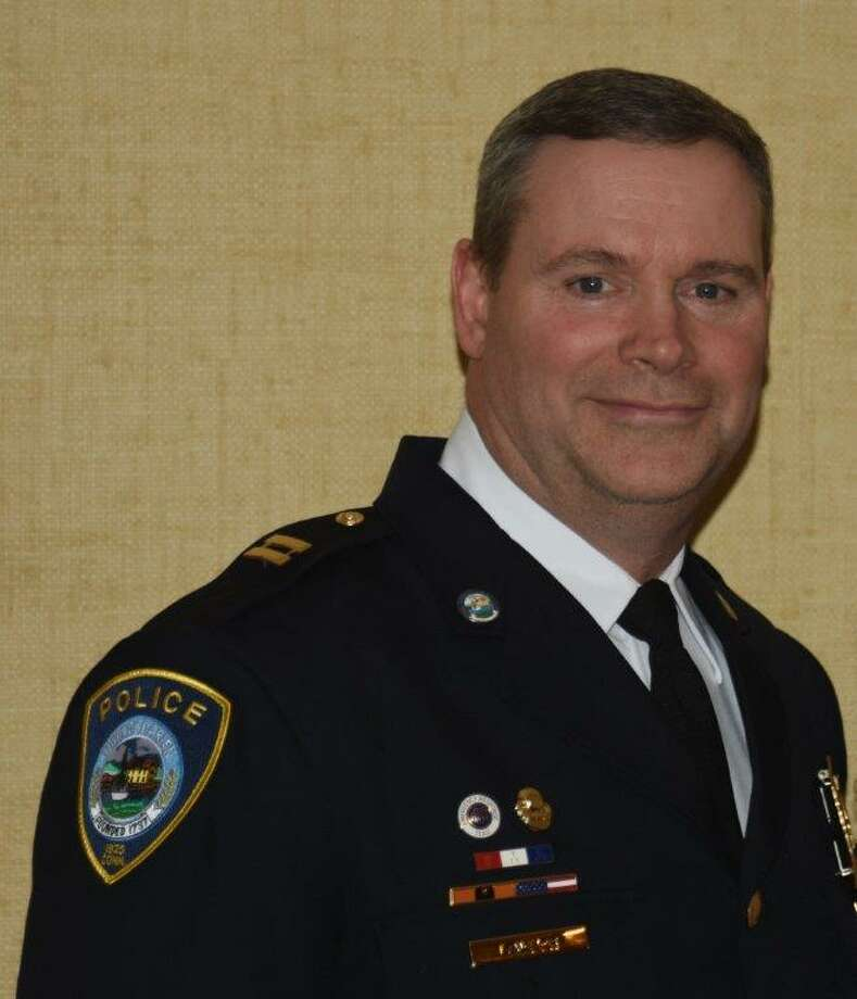 Darien Police Capt. John Lawlor retires after 33 years with the department.
