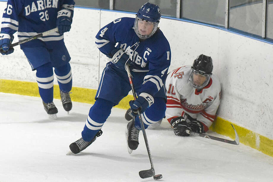 Darien's CJ Hathaway wins the puck behind the net during the Wave's 4-3 overtime victory against Fairfield Prep at the Wonderland of Ice on Saturday, Jan. 19. — Dave Stewart/Hearst Connecticut Media photo