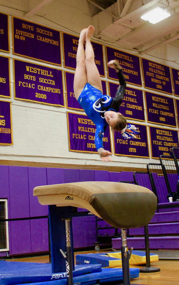 Darien junior gymnast Lana Schmidt soared on vault at the 2019 FCIAC championship meet on Saturday, scoring 8.75 for fifth place and earn a place on the All-FCIAC First Team. — Lily Fairleigh/Contributed photo