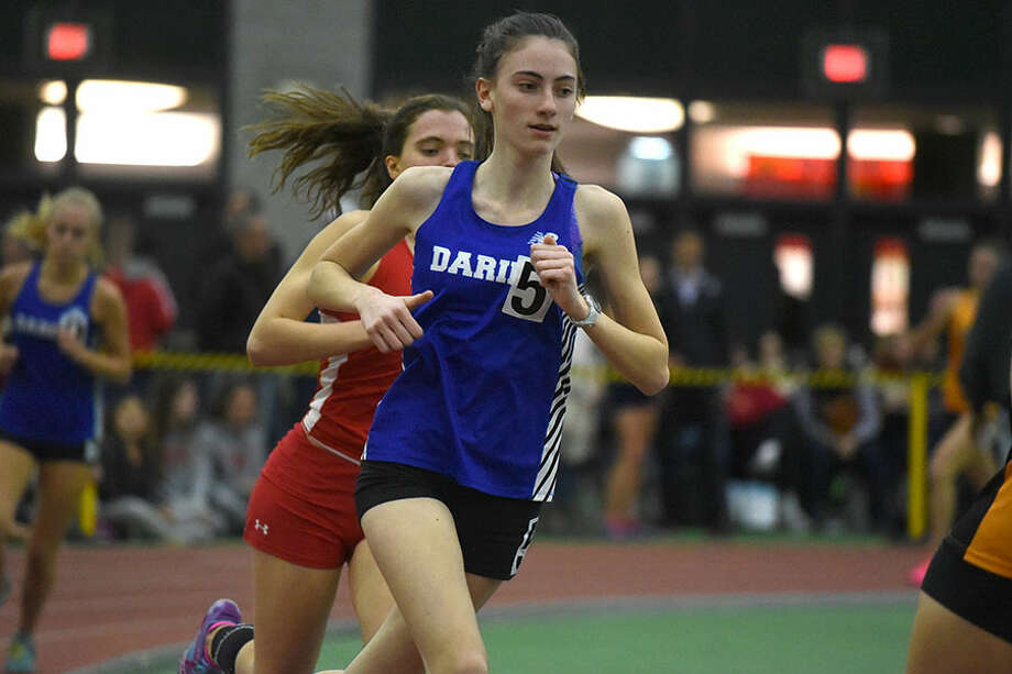 Darien freshman Mairead Clas competes in the 1,000-meter run at the FCIAC indoor track and field championships in New Haven on Thursday, Jan. 31. — Dave Stewart/Hearst Connecticut Media photo