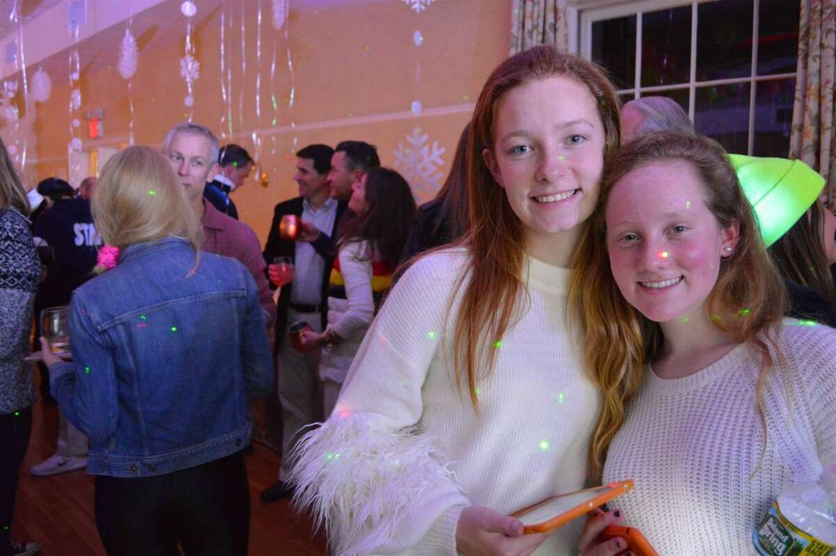 Depot members Sara McCarthy, 16, left, and Lizzie Canelli, 15, both of Darien, help out at The Darien Depot Youth Center's annual 80's Apres Ski Winter Party on Friday, Feb. 8 - All photos Jarret Liotta