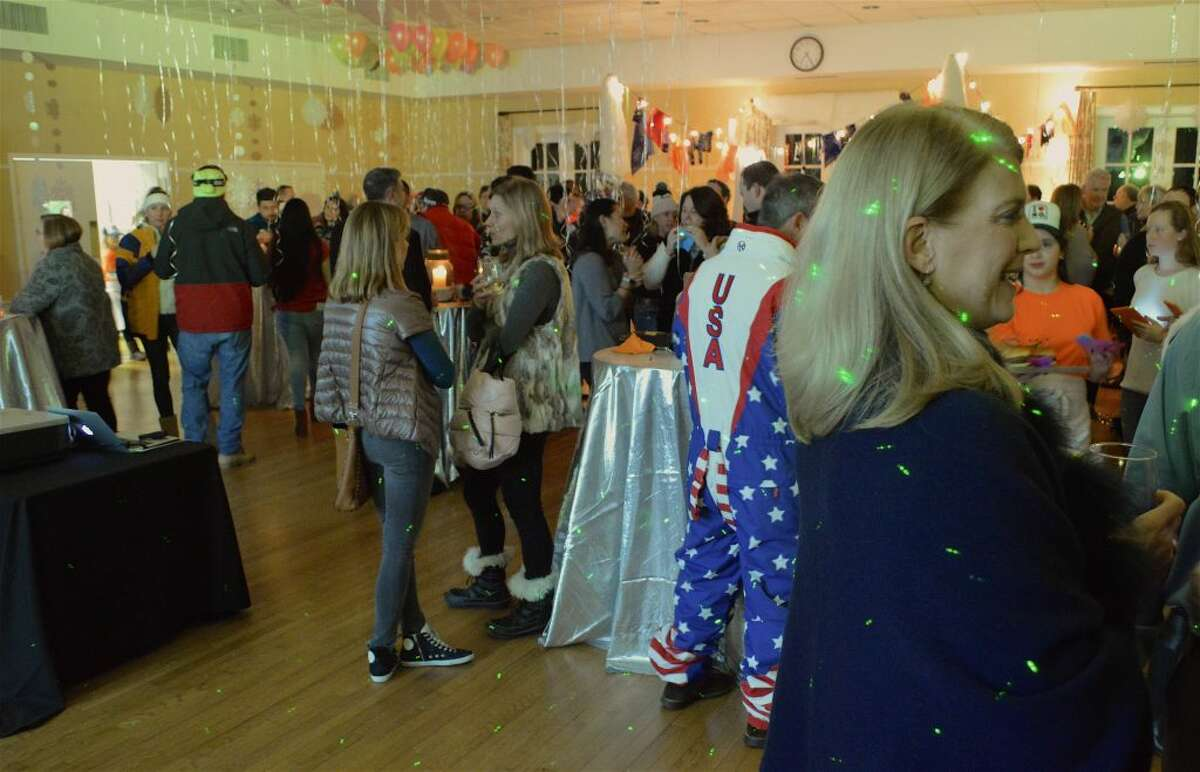 First Selectman Jayme Stevenson joins the party at The Darien Depot Youth Center's annual 80's Apres Ski Winter Party