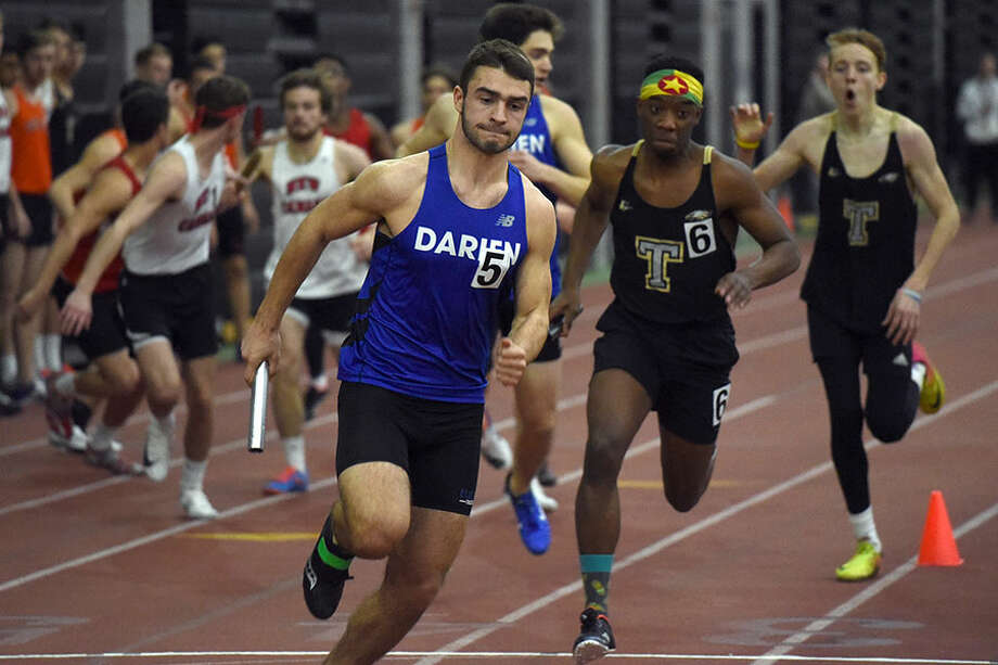 Darien's Andrew Donovan competes in the 4x400 relay at the FCIAC indoor track and field championships in New Haven on Thursday, Jan. 31. — Dave Stewart/Hearst Connecticut Media photo