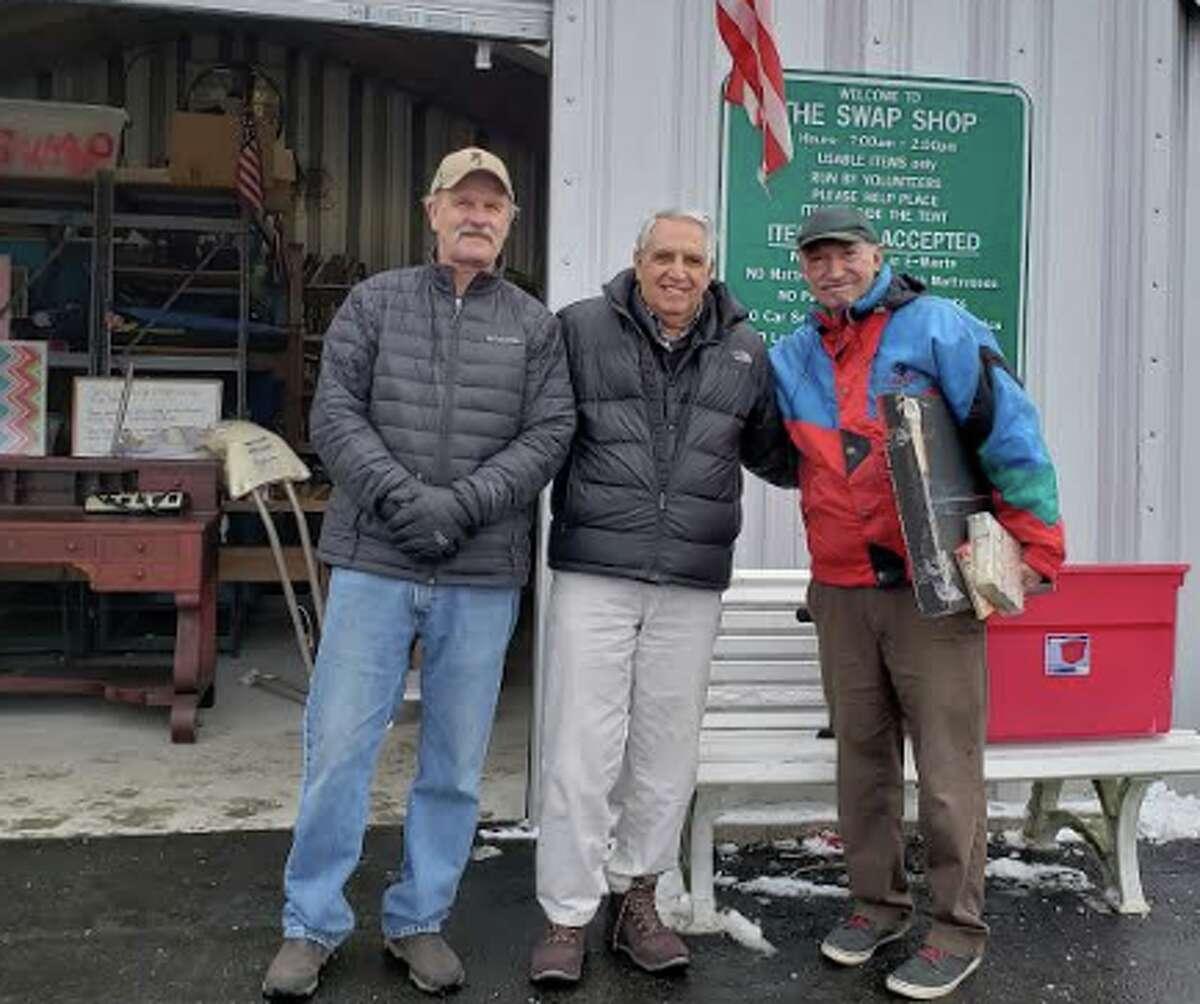 Darien resident Dan Dolcetti (center) , along with volunteer Dan Poccia and a Swap Shop customer. - Sandra Diamond Fox photo