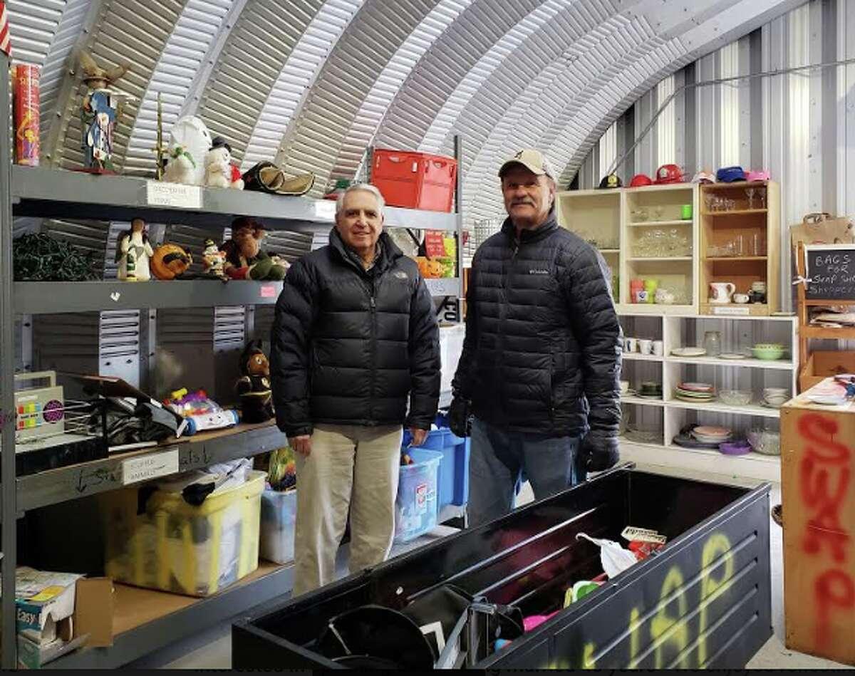 Darien resident Dan Dolcetti, along with volunteer Dan Poccia, inside the Swap Shop. - Sandra Diamond Fox photo