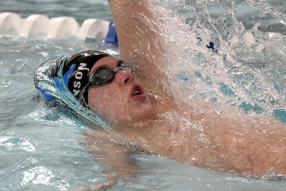 Darien's Spencer Erickson swims in the 100 backstroke during a swim meet at the New Canaan YMCA on Wednesday, Jan. 23. - Dave Stewart/Hearst Connecticut Media
