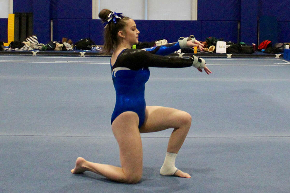 Blue Wave sophomore gymnast Lauren Grandon returned to action for Darien with an energetic new floor routine. - Contributed photo