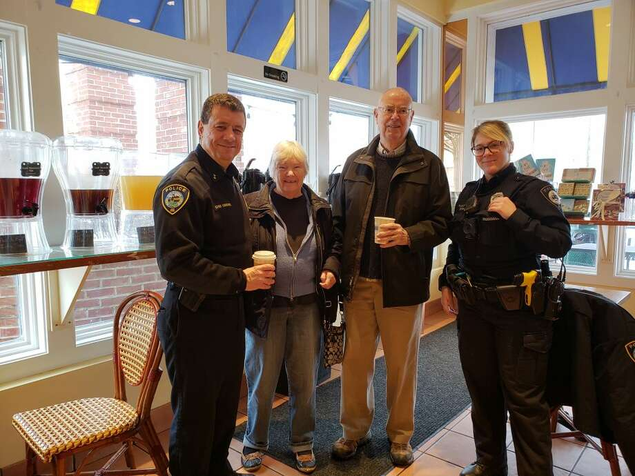 Darien Police Chief Ray Osborne; Barbara and Marc Thorne; and Patrol Officer Leslie Silva chat Friday at Coffee with a Cop.
